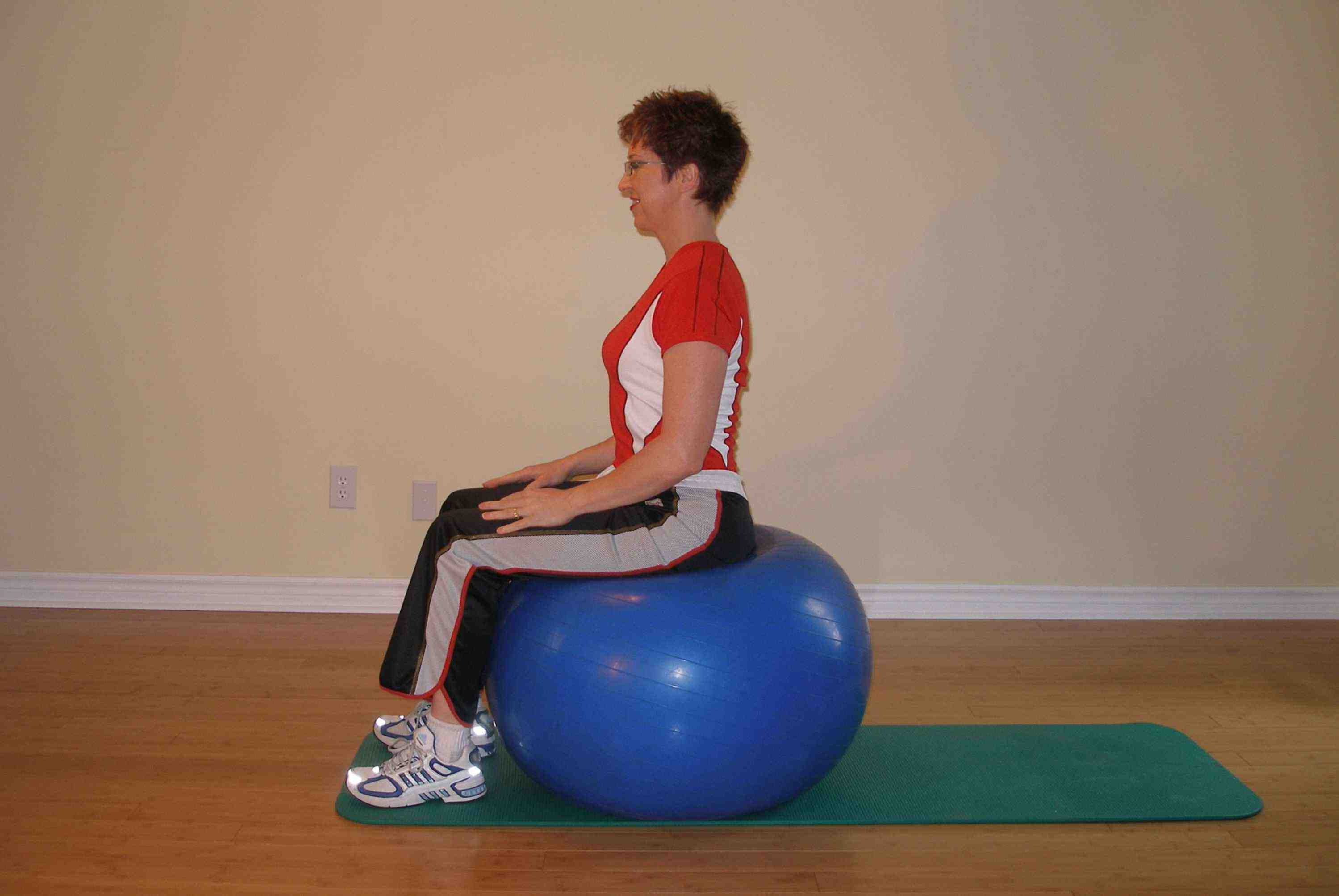 how to sit on an exercise ball