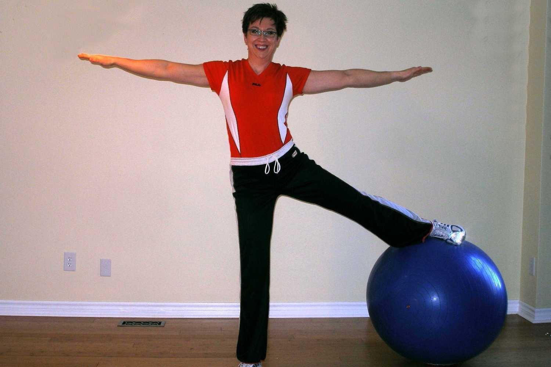 standing single leg side squat ball exercise starting position