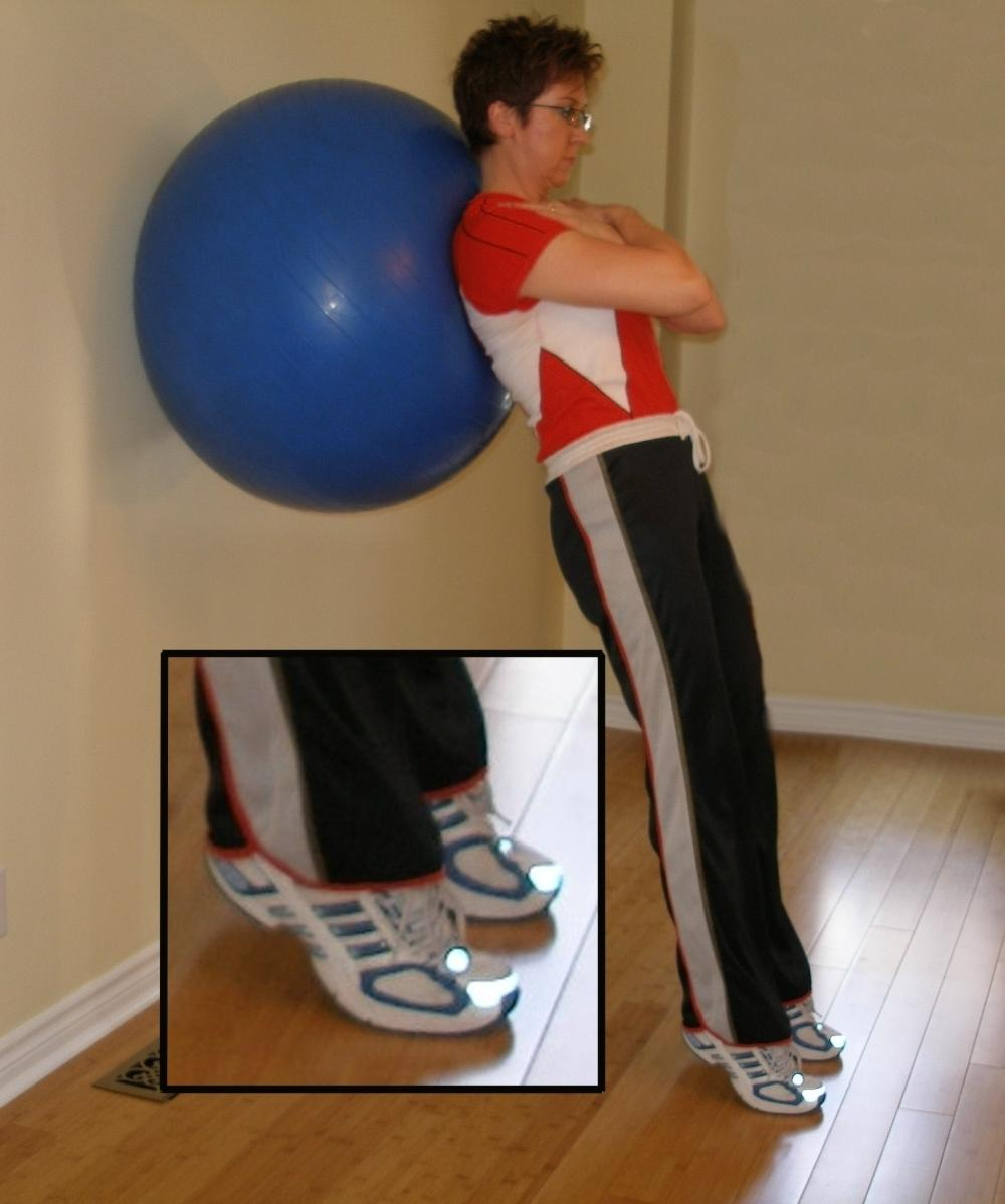 calf raise against the wall with the ball