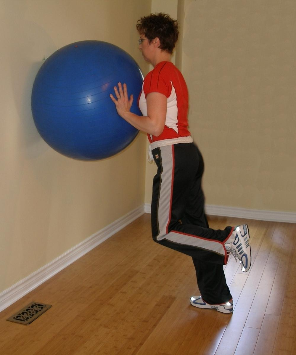 single leg calf raise withe the exercise ball starting position