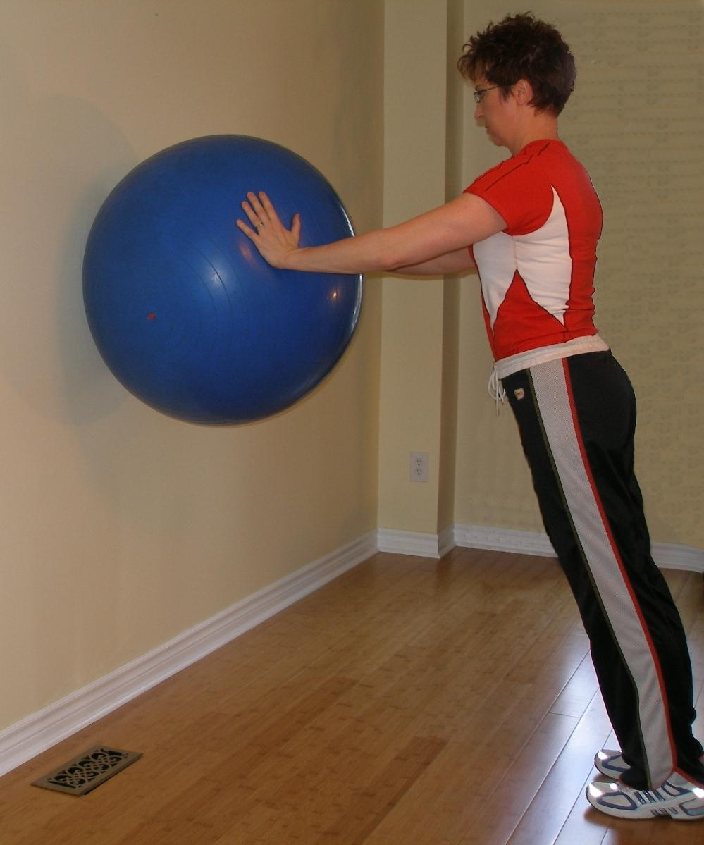 wall pushup with the exercise ball starting position
