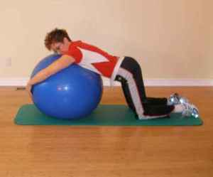 Kneeling leaning over a birth ball