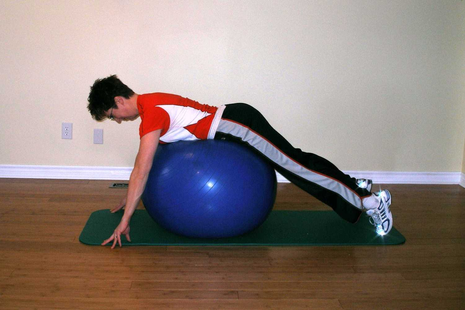 prone leg raise ball exercise start