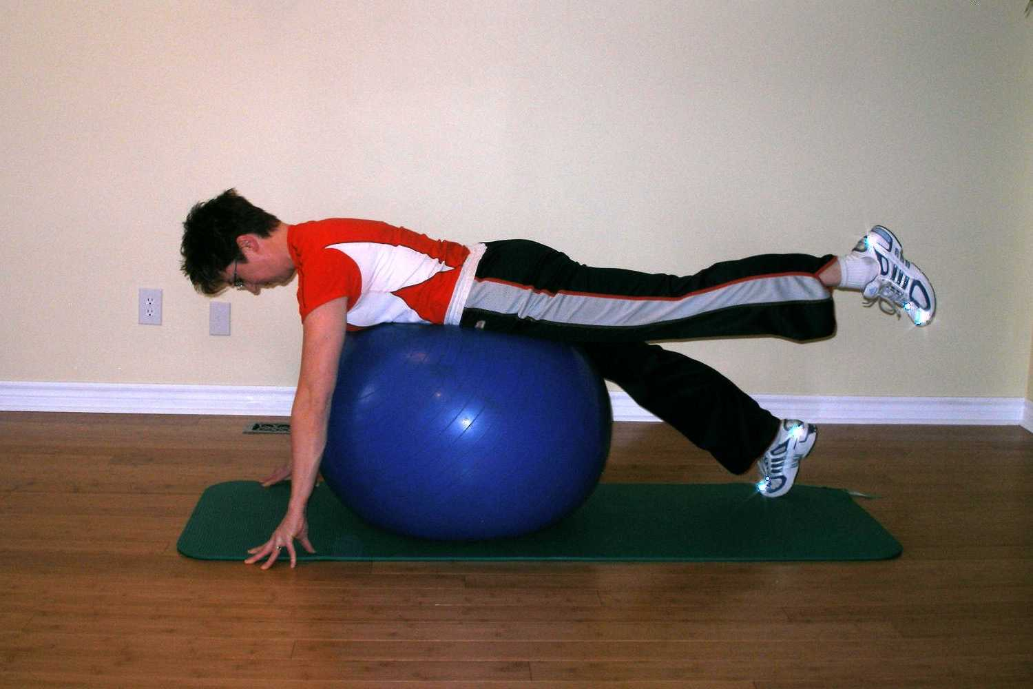 prone leg raise ball exercise finish