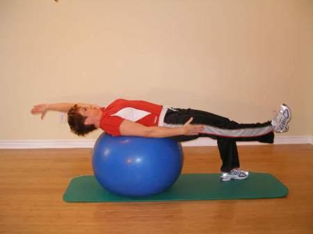 alternate arm leg raise ball exercise 1