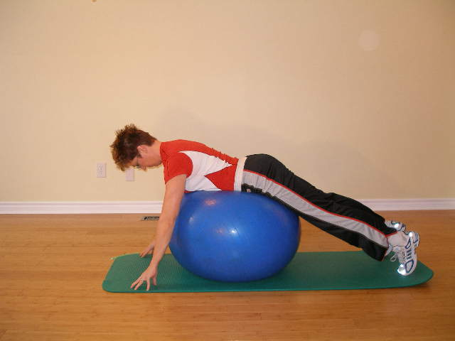 plank over the ball to start