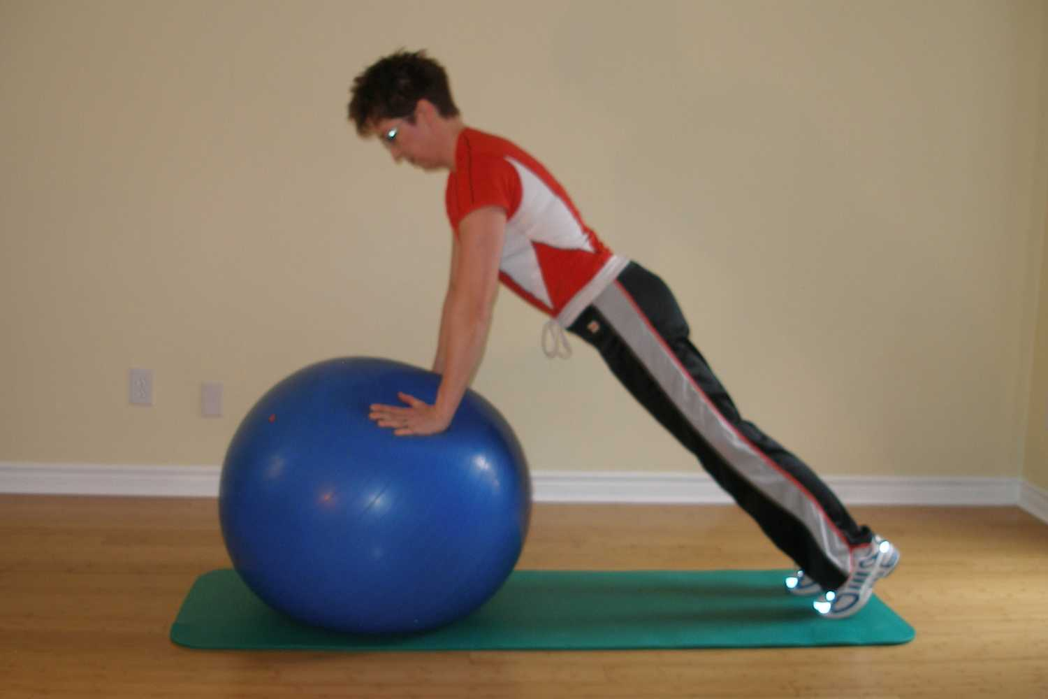 Standard push-up plus on the exercise ball