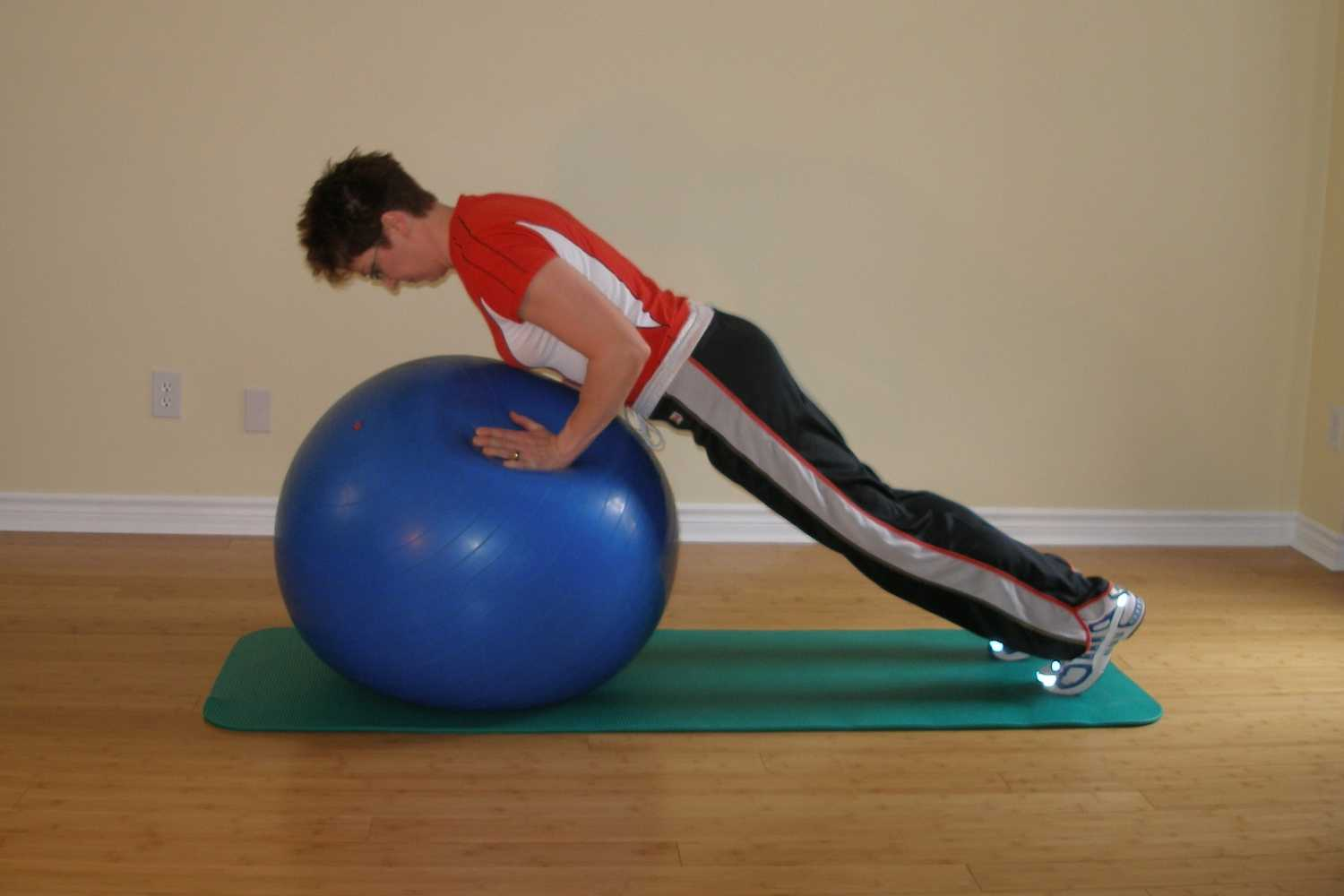 Standard push-up plus on exercise ball start