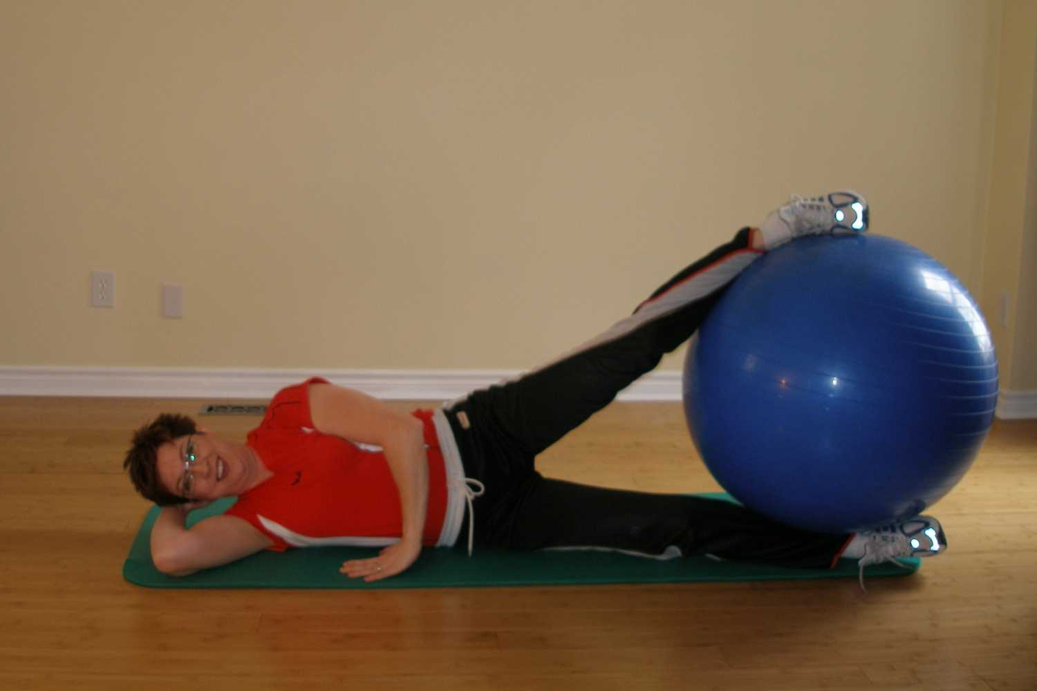 side lifts with exercise ball