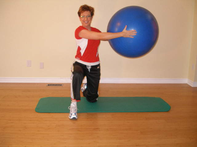 trunk rotation stretch with the exercise ball