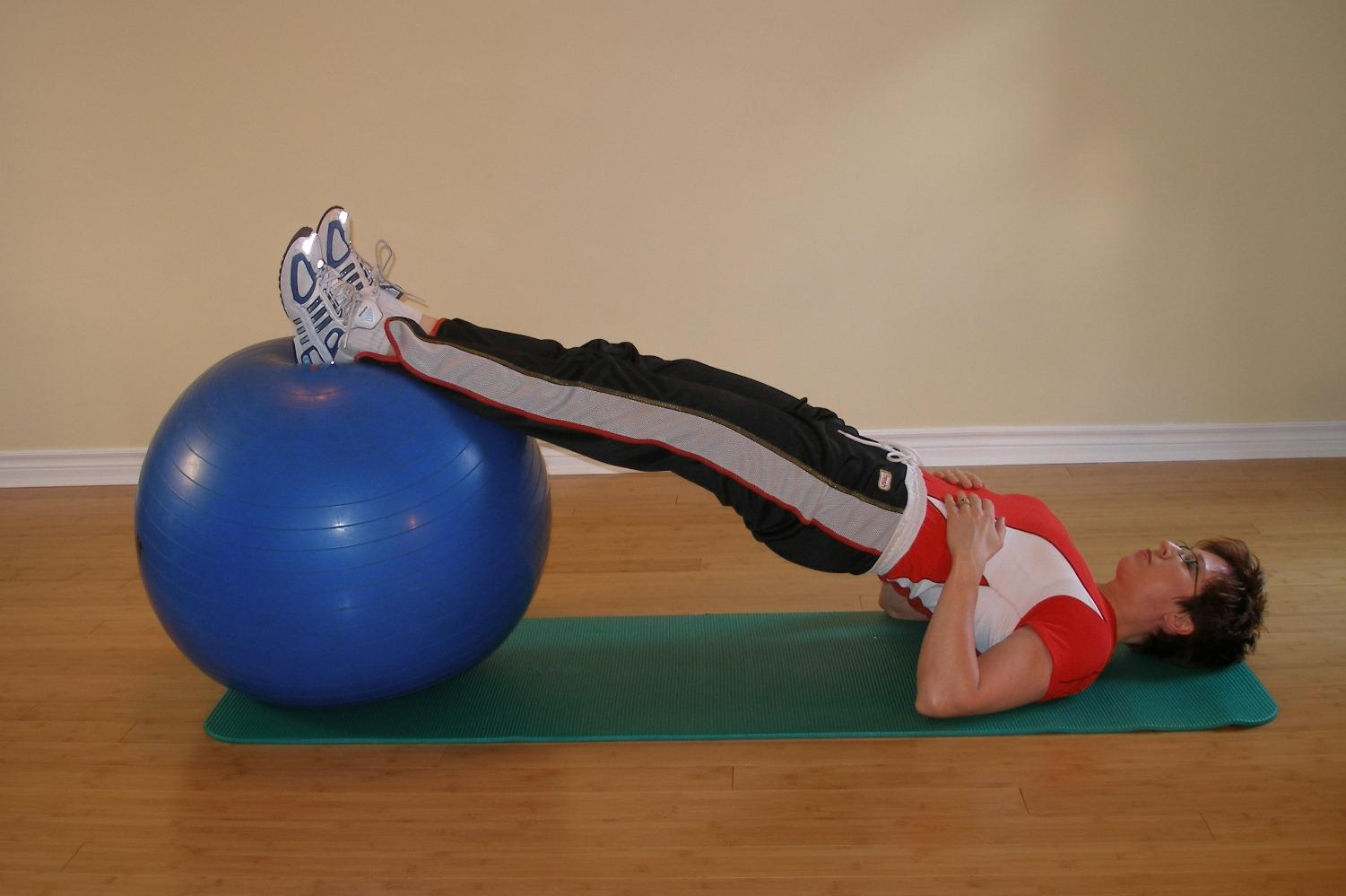 exercise ball briding hands on trunk position 2