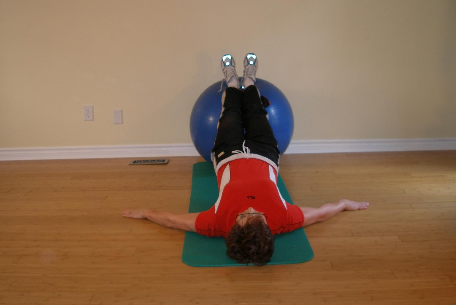 exercise ball bridge with hip roll 1