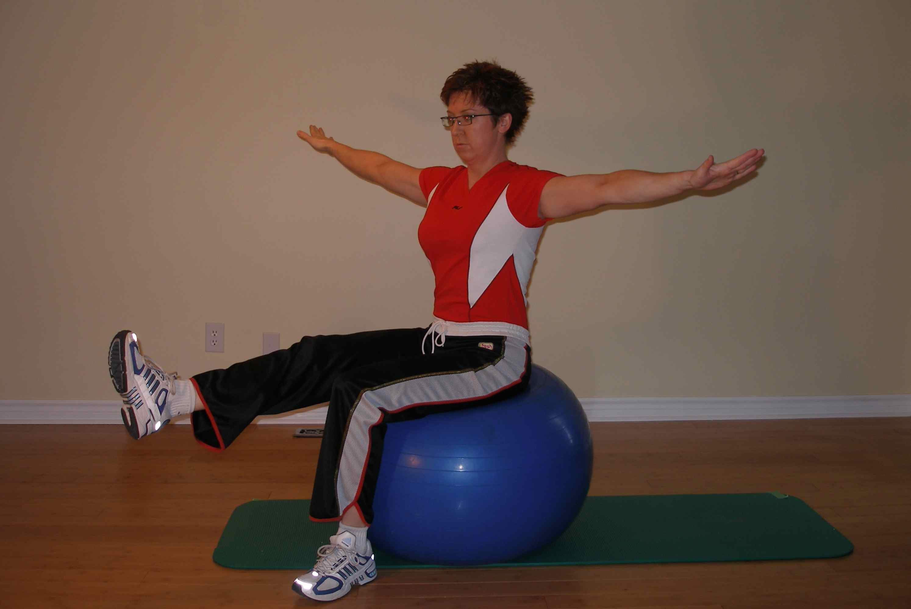 Exercise ball seated leg raise finish position