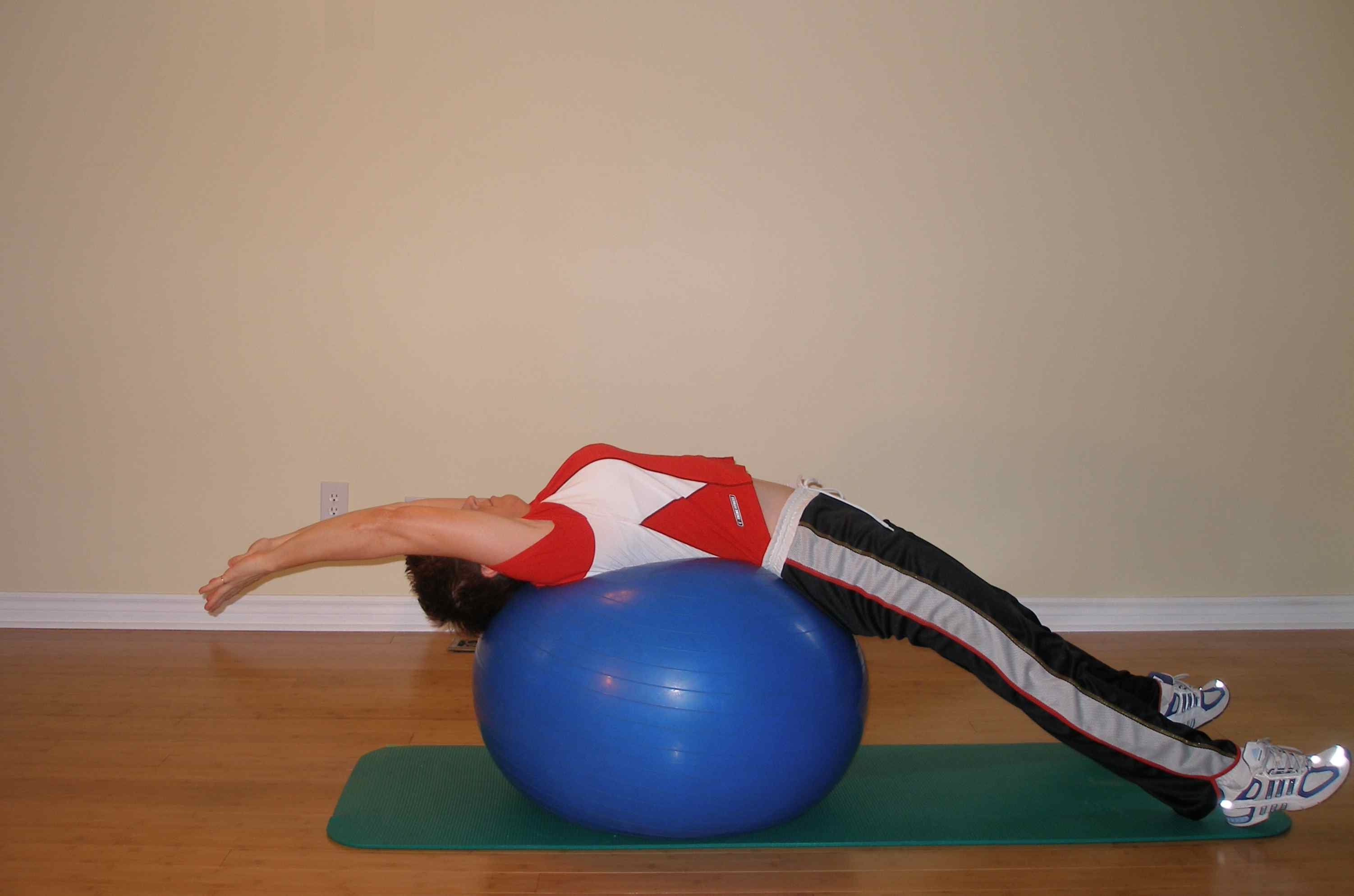 back extension over the exercise ball stretch