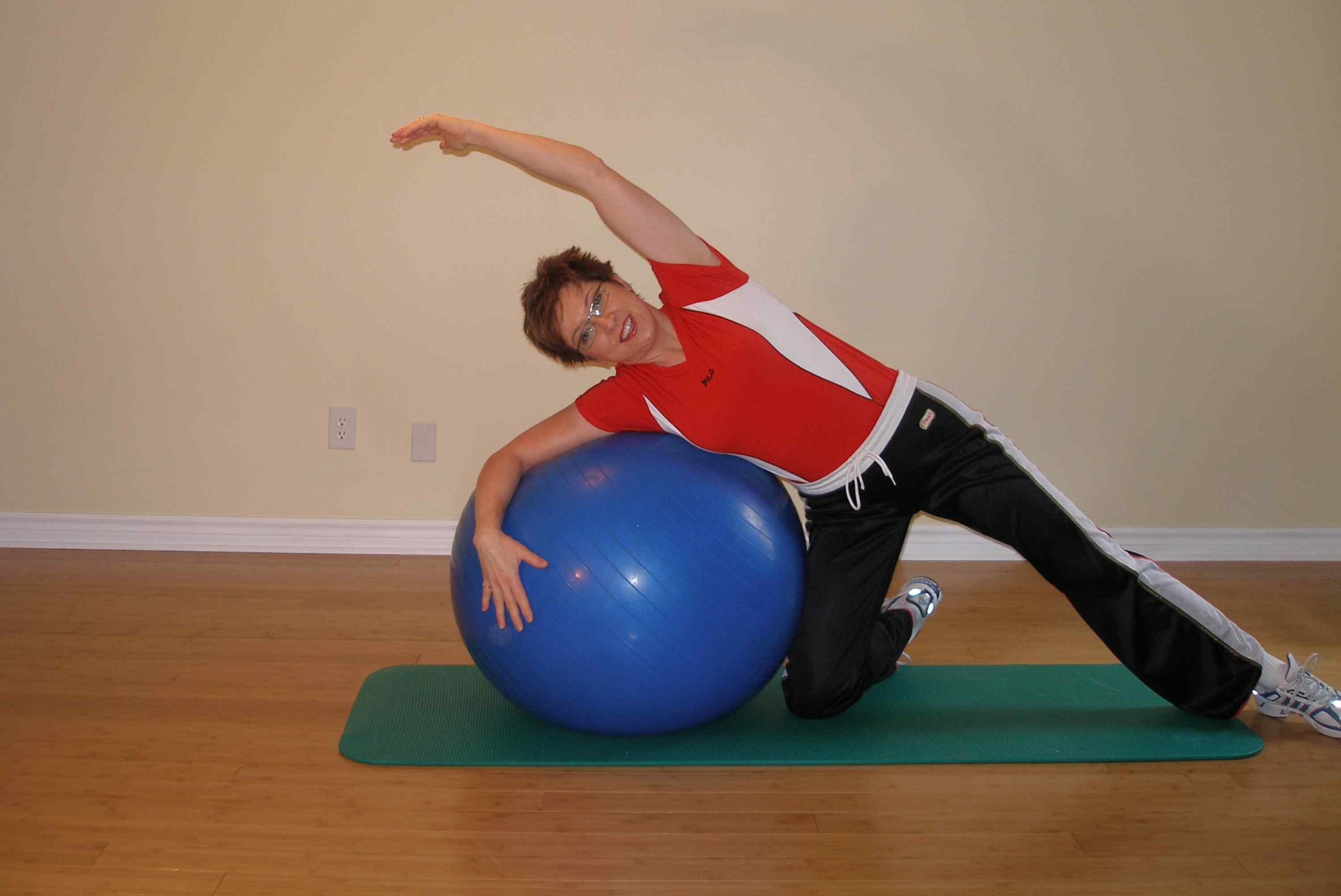 lying side stretch on the stability ball