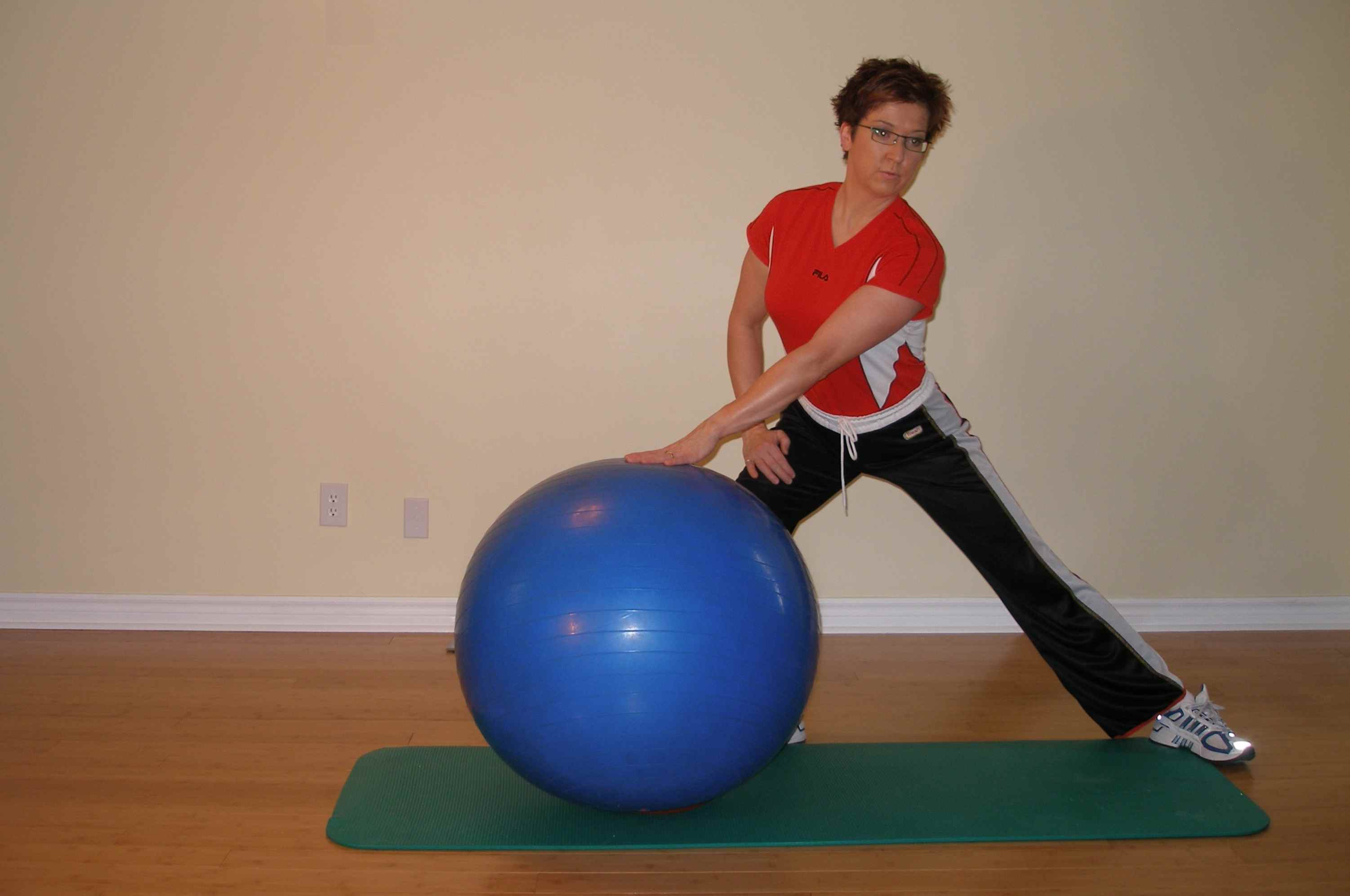 hip adductor stretch with the exerise ball