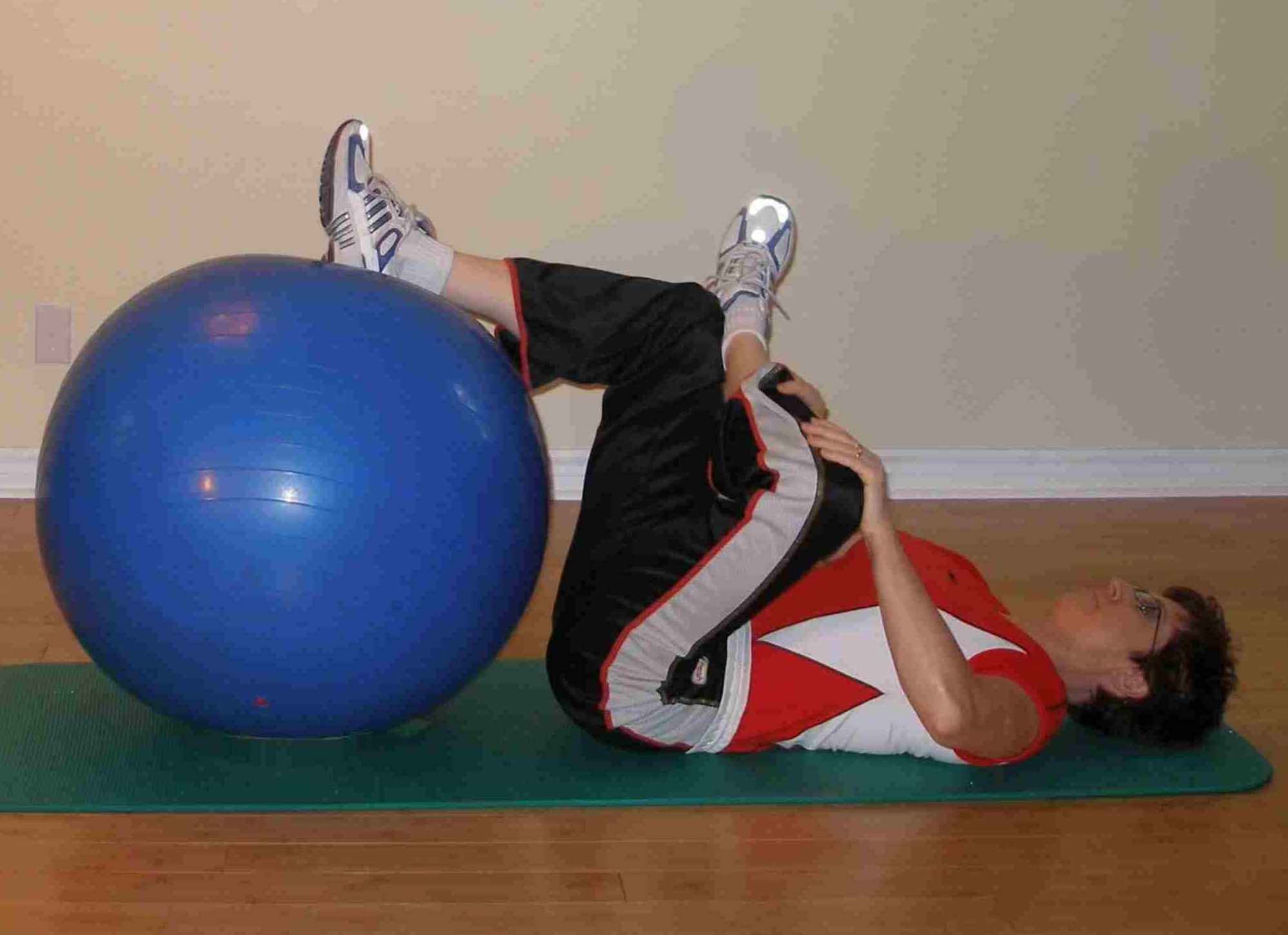 hip rotator stretch using the stability ball