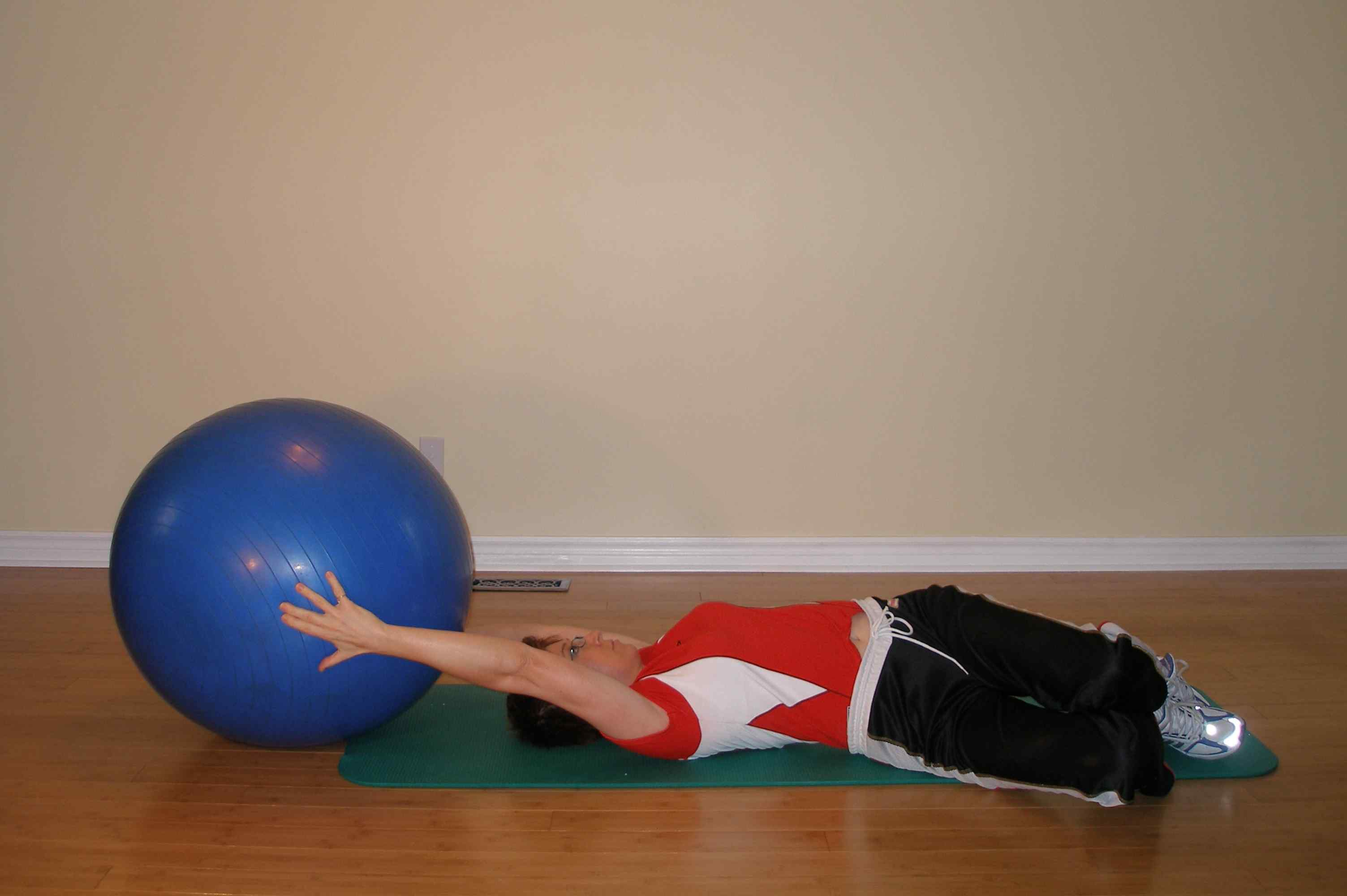 supine trunk rotation using the exercise ball