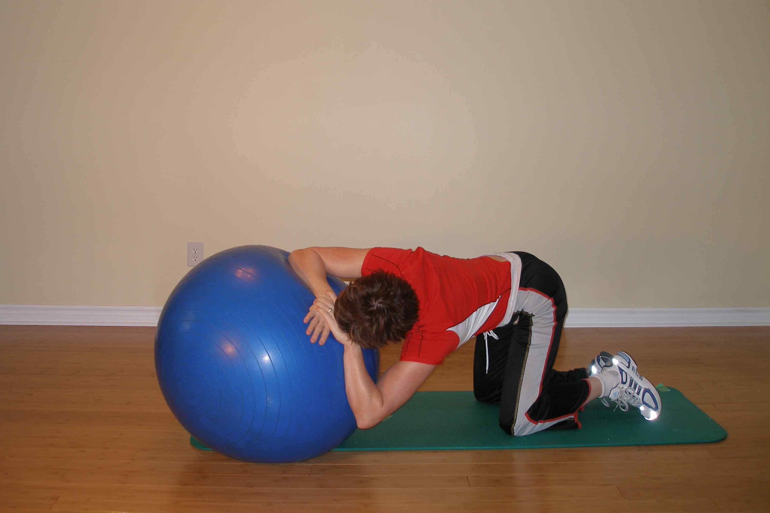 lat stretch and trunk rotation using the exercise ball