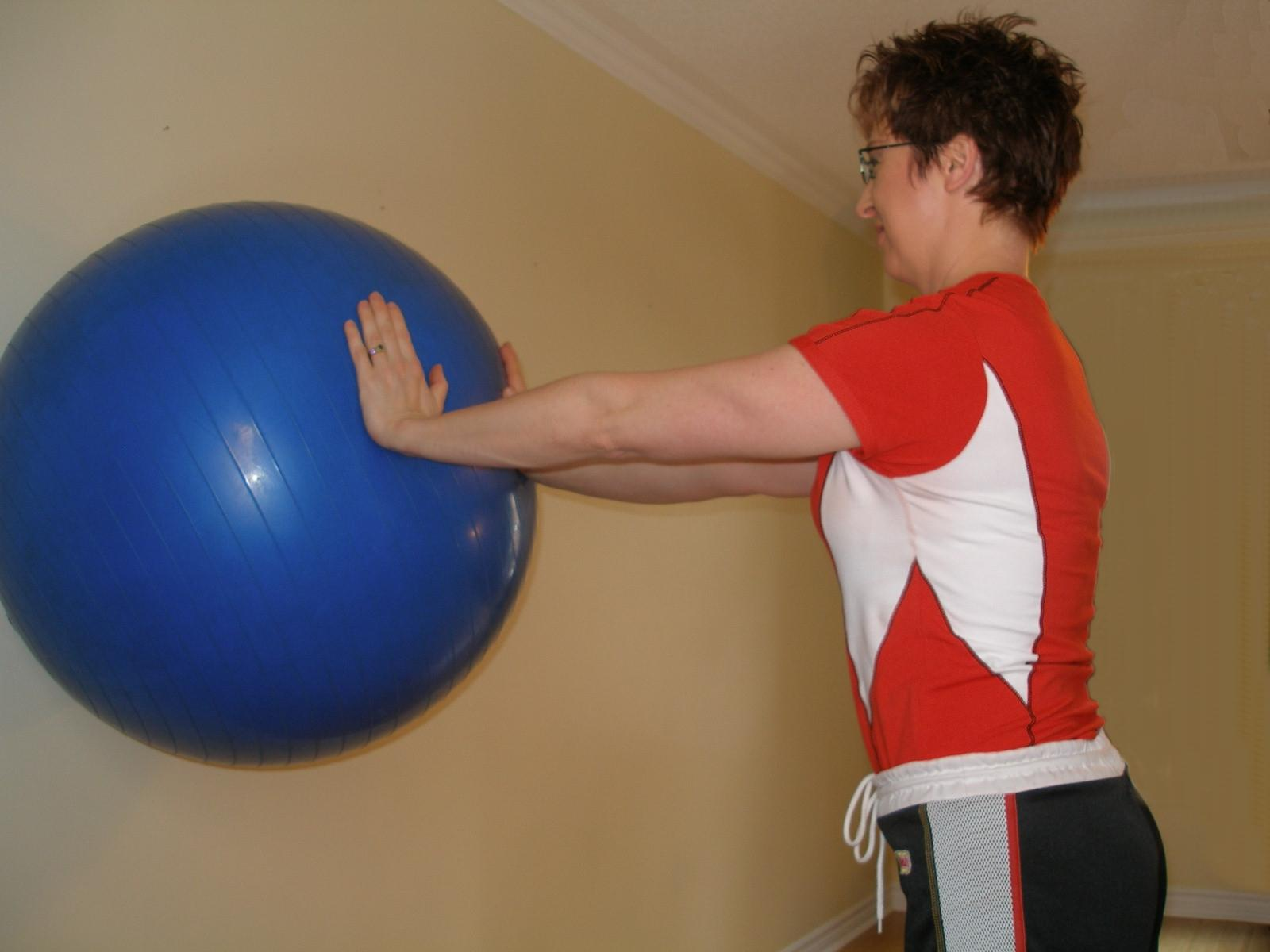 leaning straight on the exercise ball